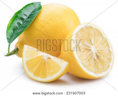 Lemon fruits and lemon slices on white background.