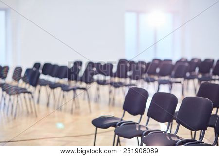 Rows of empty chairs in contemporary conference hall or large auditorium