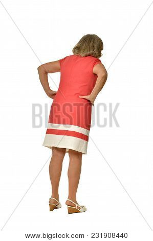 Portrait Of Senior Woman In Pink Dress Isolated On White Background