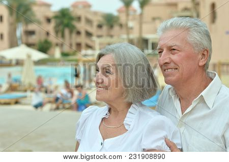 Happy Senior Couple At  Hotel Resort Hugging