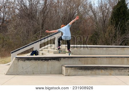 Tulsa, Oklahoma, March 2018, A Unknown Young Man Skate Boarding At A Local Park In Tulsa, Oklahoma 2