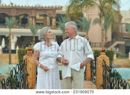 Portrait Of Happy Senior Couple At Hotel Resort