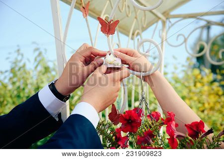 Newlyweds Hang A Lock On The Fence 1