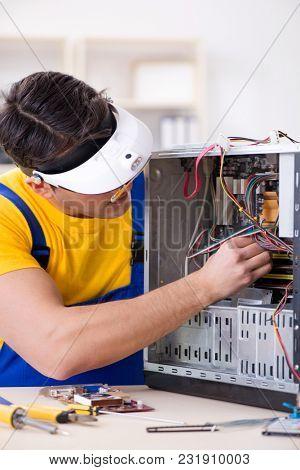 Computer repair technician repairing hardware