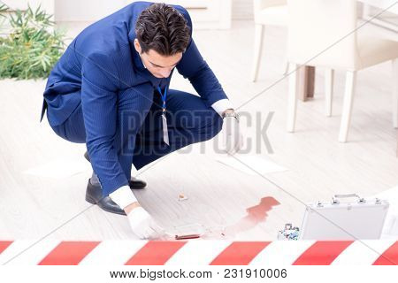 Forensics investigator at the scene of office crime