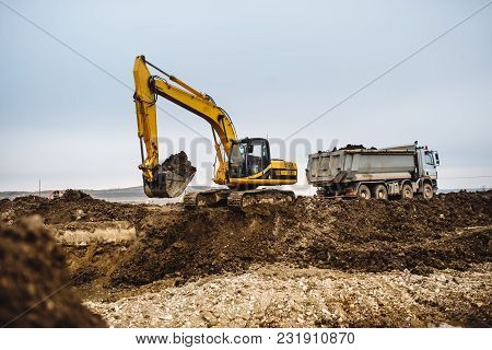 Industrial Heavy Duty Machinery, Details Of Excavator Building Highway And Loading Dumper Trucks On