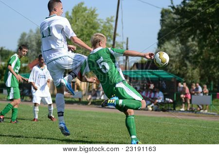 KAPOSVAR, HUNGARY - SEPTEMBER 5: Balazs Butor (green 5) in action at the Hungarian National Championship under 19 game Kaposvar (white) vs. Nagyatad (green) September 5, 2011 in Kaposvar, Hungary.