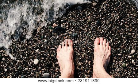 Slow Motion Of The Sea Waves Are Washed By Masculine Bare Legs