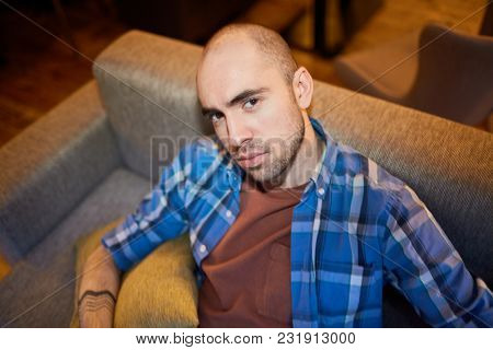 Portrait of handsome man resting on sofa