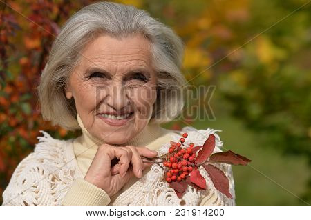 Portrait Of Senior Beautiful Woman Posing With Berries