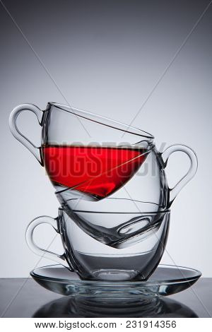 Three Glass Cups Of Tea On Saucer, Good Concept The Idea, Grey Gradient Background.