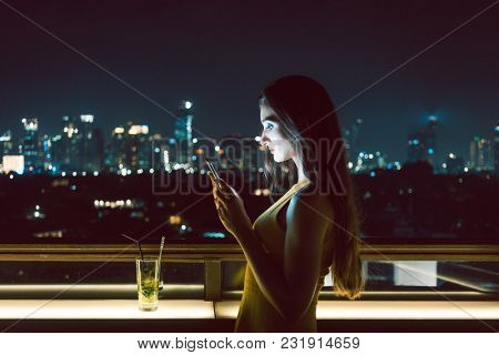 Woman receiving sad message on smart phone, her date does not show up