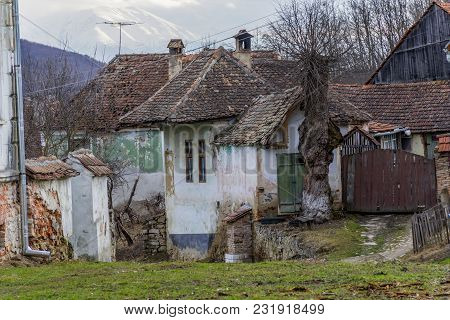 Abandoned House In Saxon Villages From Transylvania. Ancient Semi Ruined Saxon Village In Transylvan