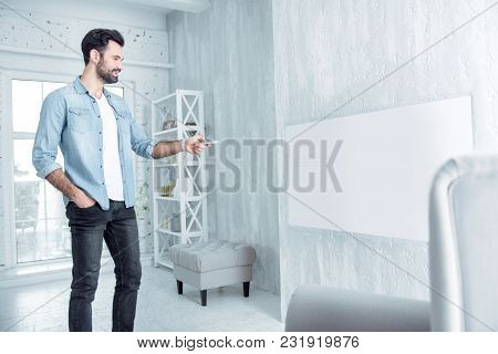 Do It Correct. Happy Freelancer Keeping Smile On His Face And Standing In Semi Position While Using