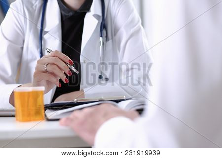 Female Doctor Hand Hold Silver Pen Filling Patient History List At Clipboard Pad. Physical, Exam, Er