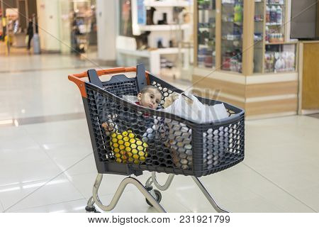 A Trolley With Products In Which The Child Sits.