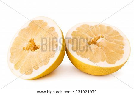 Two Halves Of Ripe Pomelo On A White Background, Isolated.