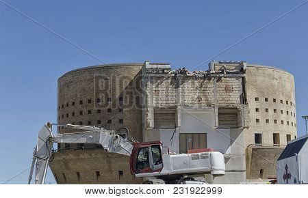 View Of An Excavator Demolishing A Building