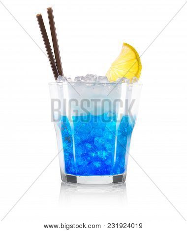 Blue Curacao Cocktail With Decoration From Fruits And Black Straw Isolated On White Background. Clip