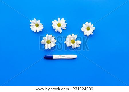 Pregnancy Test And Flowers On Blue Background Top View Mock Up
