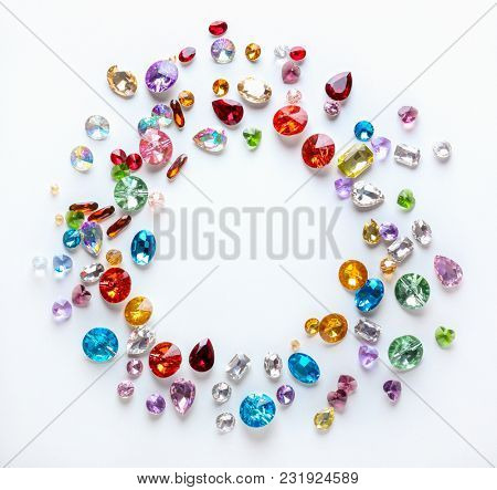 Frame made of colorful precious stones for jewellery on white background