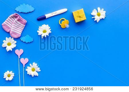 Waiting For A Baby With Positive Pregnancy Test And Flowers On Blue Background Top View Mockup