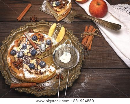 Baked Round Apple Pie And Iron Sieve With Powdered Sugar, Top View