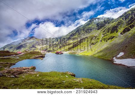 The Lake Between The Rocks. Beautiful Sky With Clouds. Wonderful Valley. Hiking And Tourism Concept.