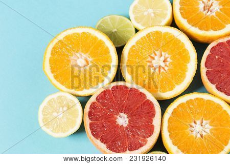 Orange And Lemon Halves On Blue Background