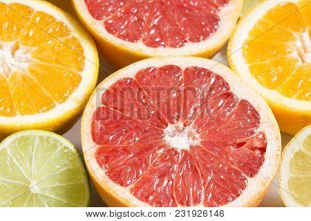 Orange And Lemon Halves Close Up As Background