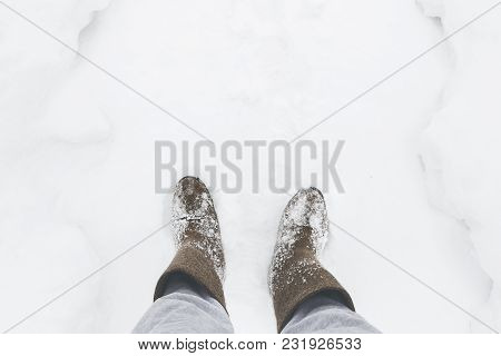 Man In Felt Boots Cleans The Path Of Snow In The Village. Rural Scene. Copy Space.