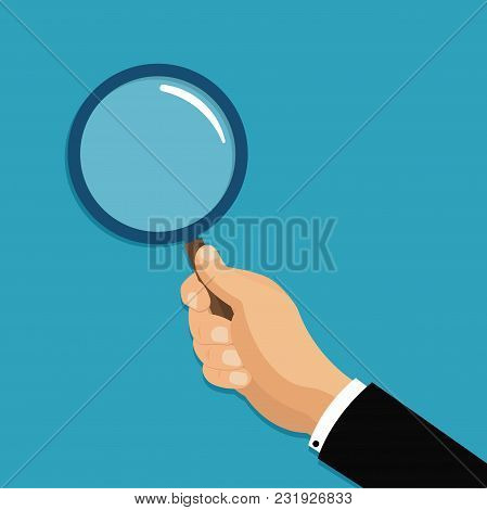Hand Holding A Magnifying Glass. Stock Vector