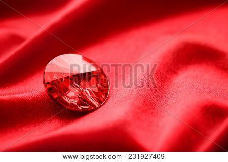 Precious stone for jewellery on red velvet