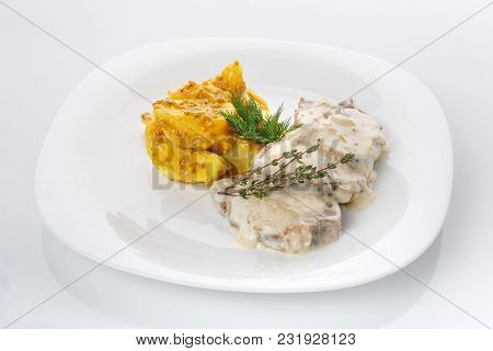 Restaurant Food. Delicious Lunch. Potatoes In French Mustard With Meat In Mushroom Sauce