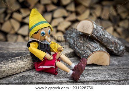 Old Wooden Pinocchio Pupett. Retro Marionette Toy