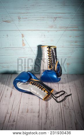 Boxing Gloves On Blue And White Cracked Wooden Background, Empty Space