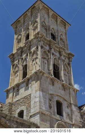 Ancient Church Of Saint Lazarus: Beautiful Bell Tower With Stone Decoration  Against The Blue Sky. O