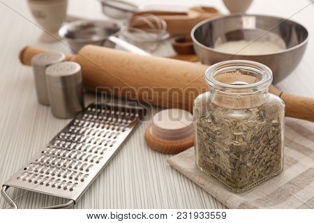 Cooking utensils and products on table