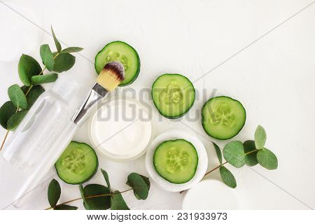 Cucumber Slices, Cosmetic Cream Jar And Tonic Mineral Water In Bottle, Fresh Green Eucalyptus Leaves
