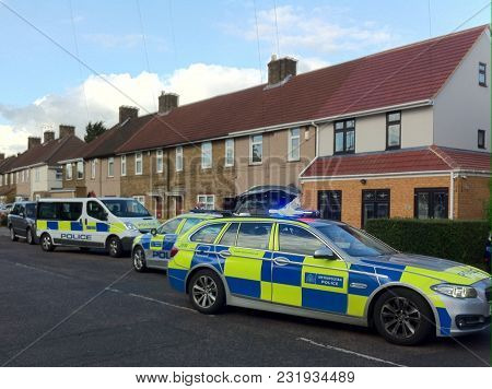 London: 12 March: 2018: Metropolitan Police Cars Attending A Crime Scene, On A Residential Road In E