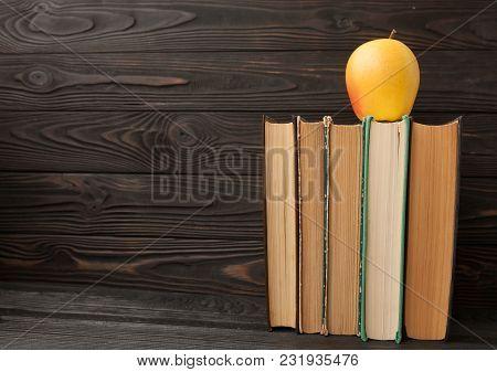 Stack Of Old Books, Wooden Background, Free Copy Space Vintage Old Hardback Books On Wooden Shelf On