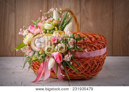 Easter Basket. Easter Basket Decorated With Flowers And Composition Of Quail Eggs