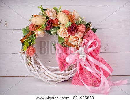 Decorative Woven Wreath Is Decorated With Flowers And Quail Eggs.
