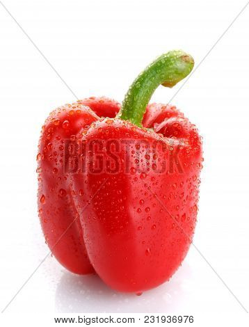 Food, Vegetable And Nutrition Concept - Red Pepper With Dew Drops Isolated On White Background