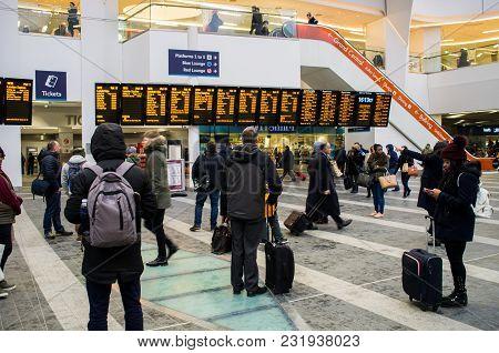Birmingham New Street, United Kingdom - March 02 2018 : Passengers Walking Inside Railway Station In