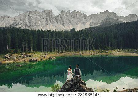 Beautiful Stylish Bride And Groom Walking In Summer Alpine Meadows In Italy, Trentino Alto Adige