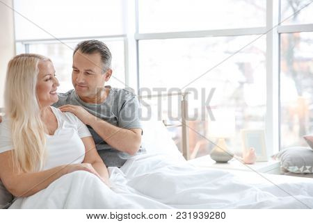 Senior couple in bed together at home