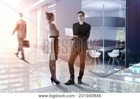 Meeting And Teamwork Concept. Businesspeople Standing In Abstract Interior With Sunlight. Double Exp