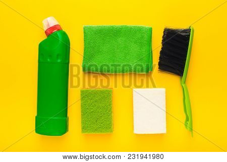 Set Of Green House Cleaning Products And Supplies On Yellow Isolated Background, Top View. Spring Cl