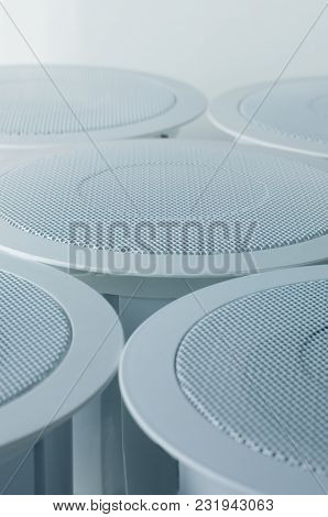White Round Circle Speakers Near Each Over. Alarm System Equipment. Soft Focus Photo Good For Securi